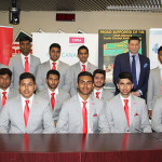 """Caption Tom posing with his """"team"""" of cricketers, resplendent in their Tom's Place suits. With the CIMA lapel pins, did a couple of guys forget their matching red pocket squares?"""