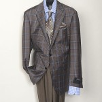 A classic look with a modern twist. Unique blue windowpane on a taupe sports jacket.